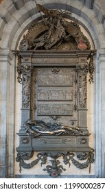 Brussels, Belgium - September 26, 2018: Evrad T'Serclaes, slain mayor, bronze statue and fresco adjacent to town hall off Grand Place, Grote markt, offers love powers to those who caress him.