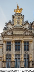 Brussels, Belgium - September 26, 2018: Top of mansion and ofices of Belgian Brewers Guild features golden equestrian statue and more frescos, text and golden decorations on brown stone palace.