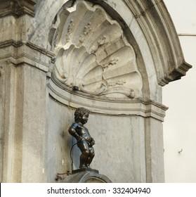 BRUSSELS, BELGIUM - SEPTEMBER 27, 2015 - Manneken Pis statue in Brussels, sculpture of a pissing boy