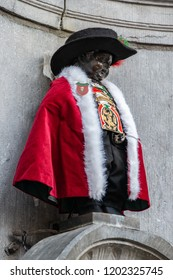 BRUSSELS, BELGIUM - SEPTEMBER 29,2018: The famous Brussels' landmark Manneken Pis in Brussels on September 29, 2018. The statue is dressed in different costumes several times a week.
