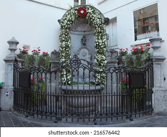 BRUSSELS, BELGIUM - SEPTEMBER 4: The famous Manneken Pis, the iconic statue of Brussels on September 4, 2014 in Brussels