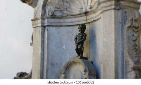 Brussels / Belgium - September 9, 2016: The Manneken Pis (little pee man in Flemish). The peeing boy is a small bronze fountain statue from the 17th century that is tall just 61cm (24 inches).
