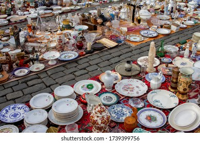 BRUSSELS, BELGIUM – summer 2017: Vintage old plates and vases for sale at flea market fair at a square called Place du Jeu de Balle