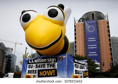 Brussels, Belgium,27th April 2018. A giant inflated model of a bee during a demonstration in front of the EU Commission offices calling the EU to adopt a ban on bee-killing neonicotinoid pesticides