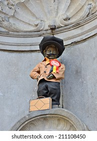 BRUSSELS, BELGIUM-AUGUST 15, 2014: Manneken Pis awarded costume dedicated to 50 anniversary of Turkish workers immigration to Belgium