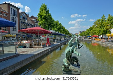 BRUSSELS, BELGIUM-JUNE 06, 2013: Quai de Bois a Bruler square, which was built on place of the old port. Favorite place for tourists searching Belgian sea food restaurants
