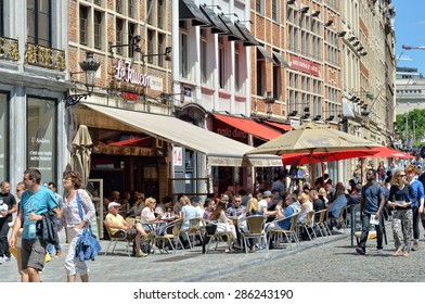 BRUSSELS, BELGIUM-JUNE 06, 2015: Tourists crowded streets and cafes in historical center of Brussels