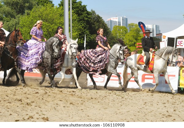 BRUSSELS, BELGIUM-JUNE 2: Group of unidentified riders shows Carrousel exercise at EuroFeria Andaluza on June 2, 2012 in Brussels. This celebration of Spanish culture is annual event in Brussels.