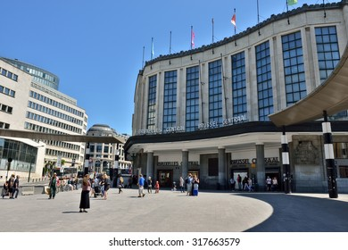 BRUSSELS, BELGIUM-JUNE 6, 2015: Tourists on the way to Central railway station in Brussels