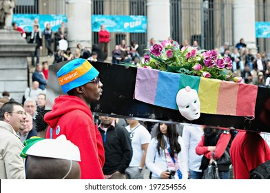 BRUSSELS, BELGIUM-MAY 15, 2010: Activists of Gay Pride Parade participate in annual defile with rainbow flag