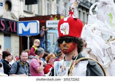 BRUSSELS, BELGIUM-MAY 19: Unknown participant demonstrates weird bright costume at Zinneke Parade on May 19, 2012 in Brussels, Belgium. This parade is an artistic biennial urban free-attendance event.