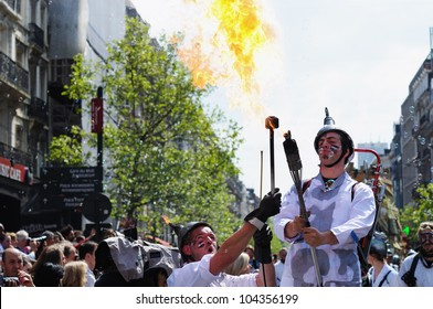 BRUSSELS, BELGIUM-MAY 19: Unknown participants play with fire during Zinneke Parade on May 19, 2012 in Brussels, Belgium. This parade is an artistic biennial urban free-attendance event