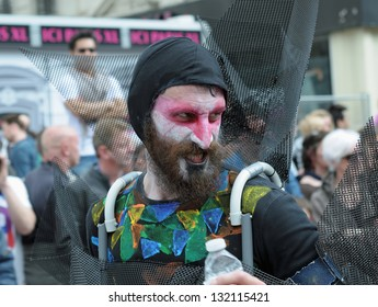 BRUSSELS, BELGIUM-MAY 22: Unidentified participant with colored face plays in scene during Zinneke Parade on May 22, 2010 in Brussels, Belgium. This parade is a biennial free-attendance artistic event