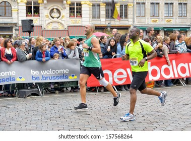 BRUSSELS, BELGIUM-OCTOBER 6: Participants arrive to the finish at Grand Place during Brussels Marathon and Half Marathon on October 6, 2013 in Brussels.