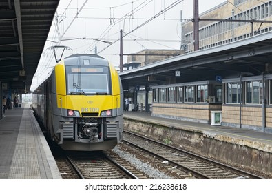 BRUSSELS, BELGIUM-SEPTEMBER 06, 2014: Train arrives to Brussels-South Railway Station or Gare du Midi. This is the biggest railway station of the city which was opened in 1952