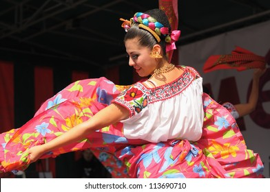 BRUSSELS, BELGIUM-SEPTEMBER 15: Dancer of Xochicalli Mexican folkloric ballet performs in a concert on Grand Place during 12 edition of Folklorissimo Festival on September 15, 2012 in Brussels.