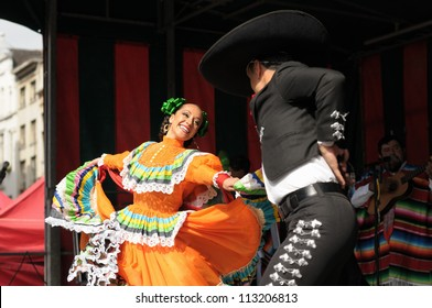 BRUSSELS, BELGIUM-SEPTEMBER 15: Dancers of Xochicalli Mexican folkloric ballet perform in concert on Grand Place during 12 edition of Folklorissimo Festival on September 15, 2012 in Brussels, Belgium.