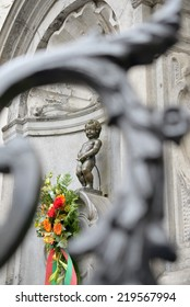 BRUSSELS, BELGIUM-SEPTEMBER 21, 2013: Manneken Pis with flowers prepared for a ceremony of award of costume