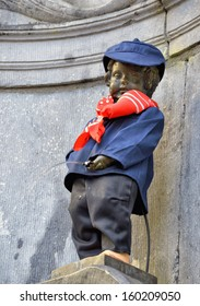 BRUSSELS, BELGIUM-SEPTEMBER 26: Manneken Pis awarded costume of folkloric personage of Schaerbeek Pogge on September 26, 2013 in Brussels, Belgium