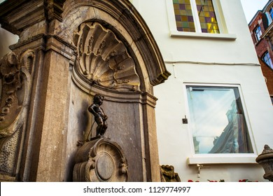 Brussels (Bruxelles), Belgium - March 21, 2018 - Street view of Mannekin Pis, or le Petit Julien, on a corner of the center of Brussels