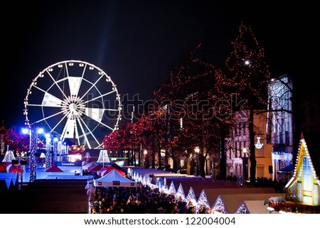 BRUSSELS - DECEMBER 9: Huge Ferris wheel in place Saint Catherine at Winter Wonders Christmas market on December 9, 2012 in Brussels.