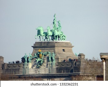 """BRUSSELS - FEBRUARY 25: Tourists on top of the  centrepiece triumphal arch in Parc du Cinquantenaire (French for """"Park of the Fiftieth Anniversary). Photo taken on February 25, 2018 in Brussel"""