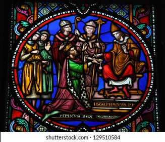 BRUSSELS - JULY 26: Pepin the Younger re-consecrated as king by Pope Stephen II in 754, on a stained glass window in the cathedral of Brussels, Belgium, on July 26, 2012.