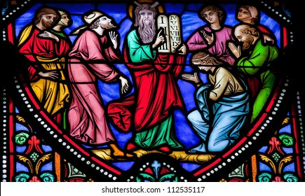 BRUSSELS - JULY 26: Stained glass window depicting Moses and the Stone Tablets with the Ten Commandments in the cathedral of Brussels on July, 26, 2012.