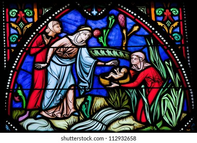 BRUSSELS - JULY 26: Stained glass window depicts Moses found in a basket in the Nile by Pharaoh's daughter, in the cathedral of Brussels on July, 26, 2012.