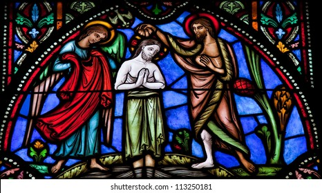 BRUSSELS - JULY 26: Stained glass window depicts Jesus baptized in the river Jordan by Saint John the Baptist, in the cathedral of Brussels on July, 26, 2012.