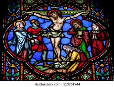 BRUSSELS - JULY 26: Stained glass window depicting Jesus on the cross in the cathedral of Brussels on July, 26, 2012.