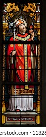 BRUSSELS - JULY 26: Stained glass window depicting Saint Augustine in the cathedral of Brussels on July, 26, 2012.