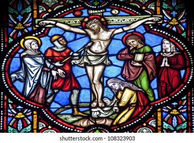 BRUSSELS - JUNE 22: Crucifixion from windowpane in st. Michael s gothic cathedral on June 22, 2012 in Brussels.