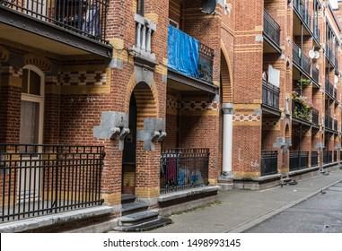 Brussels Marollen, Brussels Capital Region / Belgium - 09 07 2019: Narrow Streets with social blocks in bricks stone walls