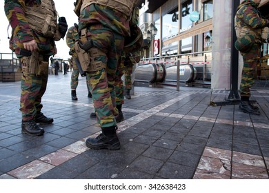 BRUSSELS - NOVEMBER 23: Belgium Army and police at Porte de Namur metro station in Brussels as part of security lock-down following terrorist threats. on November 23, 2015 in Brussels, Belgium.