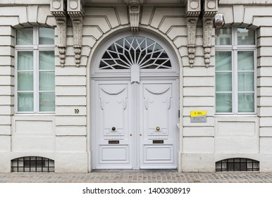 Brussels Old Town / Belgium - 05 17 2019: Neoclassical facade and door of the Place des Martyrs, the Martyrs' square with the official residence and offices of the Flemish ministers