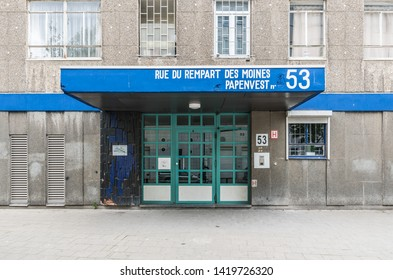 Brussels Old Town / Belgium - 06 07 2019: Entrance and facade of the social block Rempart des Moines - Papenvest - Monks Ramparts