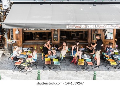 Brussels Old Town / Belgium - 06 25 2019: Young people having a drink at the terraces of the Halles Saint-Géry -  Sint Goriks Hallen
