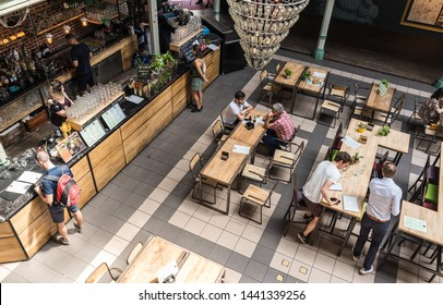 Brussels Old Town / Belgium - 06 25 2019: People having a drink at the Halles Saint-Géry -  Sint Goriks Hallen