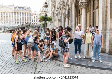 Brussels Old Town / Belgium - 06 25 2019: Schoolgroup of teenage girls from a Polish highschool visting the Grande Place