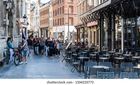 Brussels Old Town, Brussels Capital Region / Belgium - 09 14 2019: Tourists walking in the gay quarter in old town