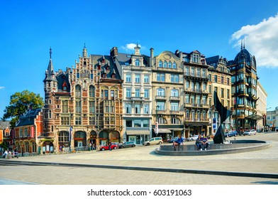 BRUSSELS, SEP, 25, 2011: Colorful Gothic architecture buildings houses in Brussels down town center fountain. Walking tourists. Classical European architecture. Famous Belgium holidays vacations tours
