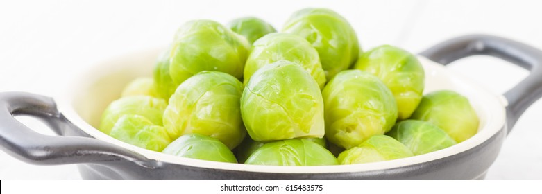 Brussels Sprouts - Cooked brussels sprouts on a white background.