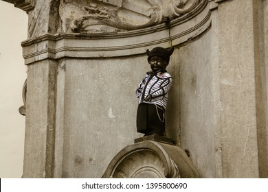 Brussels/Belgium; 04/29/2016. Famous Statue Manneken Pis in Brussels. Statue dressed in traditional costume.