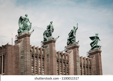 Brussels/Belgium - August 20th 2014: Four statues on top of Hall 5 Brussels Expo building