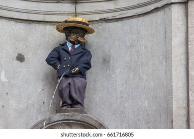 BRUSSLES,BELGIUM-April 23 '2017 : Manneken Pis statue near grand place landmark of Brussels city where tourist people visit this place.