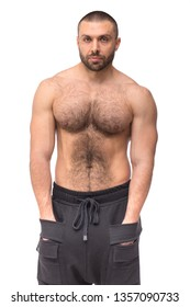 Brutal beard muscular man in studio on white background fitness model healthcare lifestyle with topless body strong arms