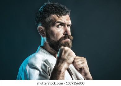 Brutal bearded boxer, ready to fight.
