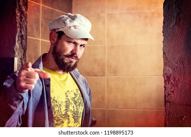 "Brutal bearded man in a eight-blade cap indignantly frowned, pointing his finger to the question ""Your Country Needs You?"" or ""Are you among the volunteers?"""