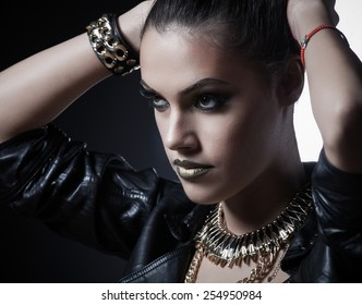 Brutal beautiful sexy woman in a leather clothes